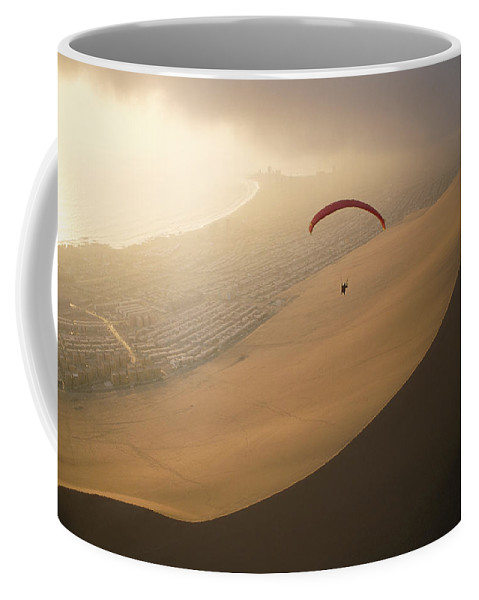 South America Coffee Mug featuring the photograph Ocean Gusts Keep A Paraglider Aloft by Joel Sartore