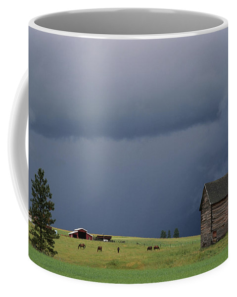 North America Coffee Mug featuring the photograph Ominous Clouds Gather Over Horses by Annie Griffiths