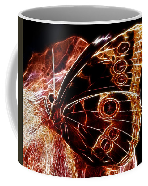 Owl Eye Coffee Mug featuring the photograph Owl Eye Butterfly by Chris Thaxter