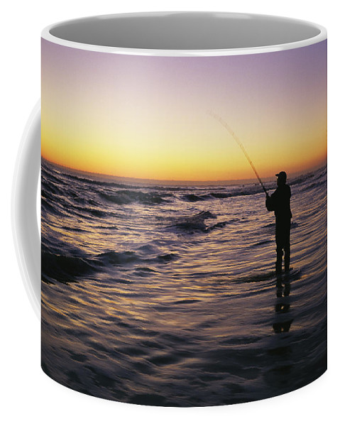 Fishing And Fishermen Coffee Mug featuring the photograph People Are Surf Fishing For Red Drum by Stephen Alvarez