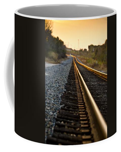 Train Coffee Mug featuring the photograph Railroad Tracks At Sundown by Carolyn Marshall