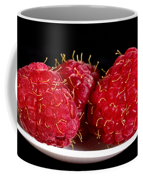 Art Coffee Mug featuring the photograph Red Raspberries On A White Spoon Against Black No.0102 by Randall Nyhof