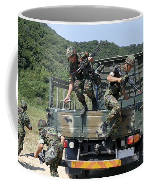 Exiting Coffee Mug featuring the photograph Republic Of Korea Marines Dismount by Stocktrek Images