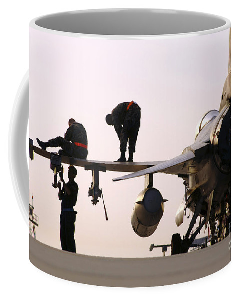 Aircraft Coffee Mug featuring the photograph Rew Chiefs Prepare An F-16 Fighting by Stocktrek Images