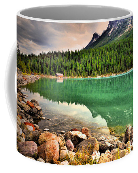 Lake Louise Coffee Mug featuring the photograph Rocks And Reflections by Tara Turner