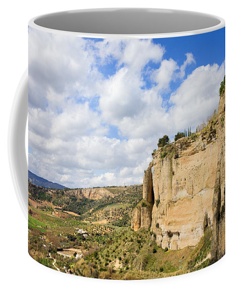 Andalucia Coffee Mug featuring the photograph Ronda Cliffs In Andalusia by Artur Bogacki
