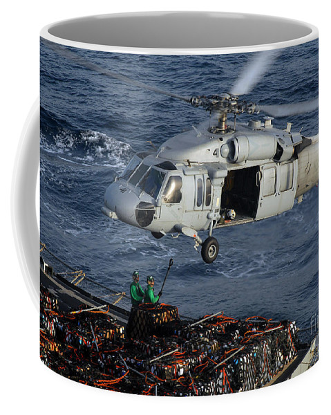 Adults Only Coffee Mug featuring the photograph Sailors Attach Pallets Of Supplies by Stocktrek Images