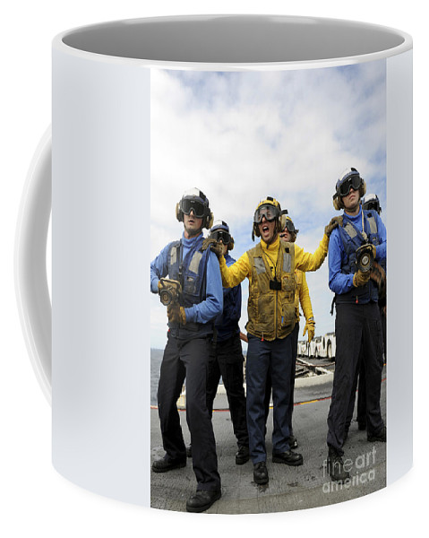 Flight Deck Coffee Mug featuring the photograph Sailors Fight A Simulated Fire Aboard by Stocktrek Images