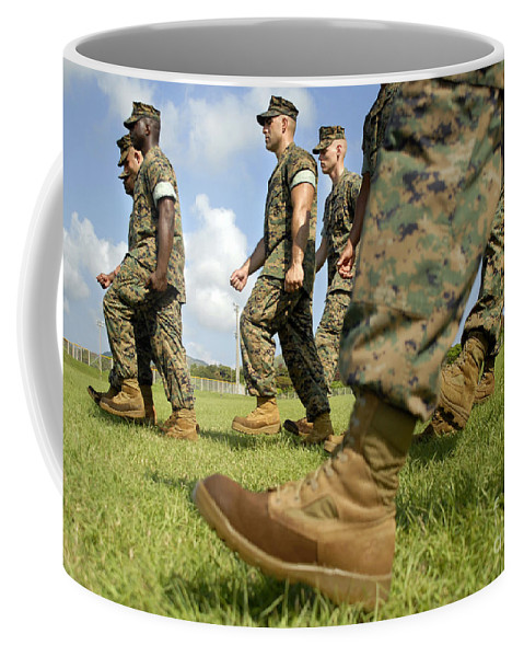 Boots Coffee Mug featuring the photograph Sergeant, Foreground, Leads A Small by Stocktrek Images