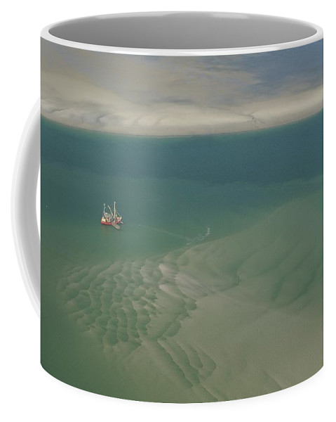 Europe Coffee Mug featuring the photograph Shrimp Boat Hovers Above Rippled Sand by Norbert Rosing