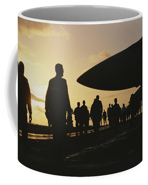 Aircraft Coffee Mug featuring the photograph Silhouetted Military Personnel by Medford Taylor