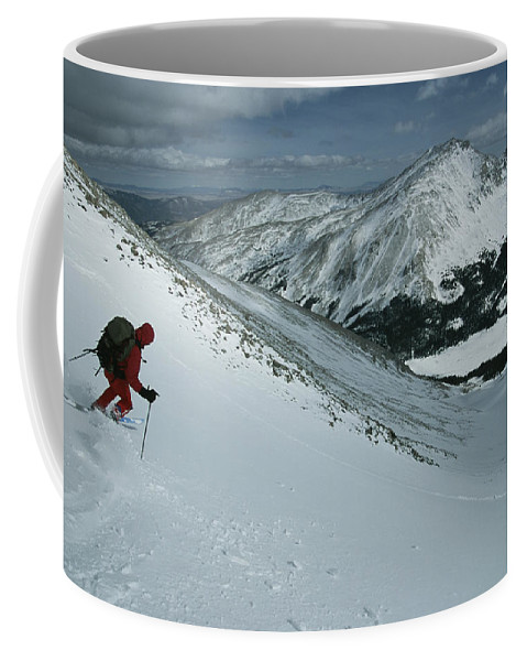 Model Released Photography Coffee Mug featuring the photograph Skier Phil Atkinson Begins His Descent by Tim Laman