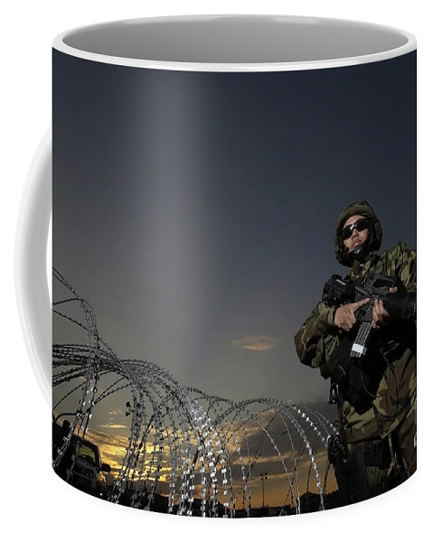 Color Image Coffee Mug featuring the photograph Soldier Patrols The Perimeter Of Camp by Stocktrek Images