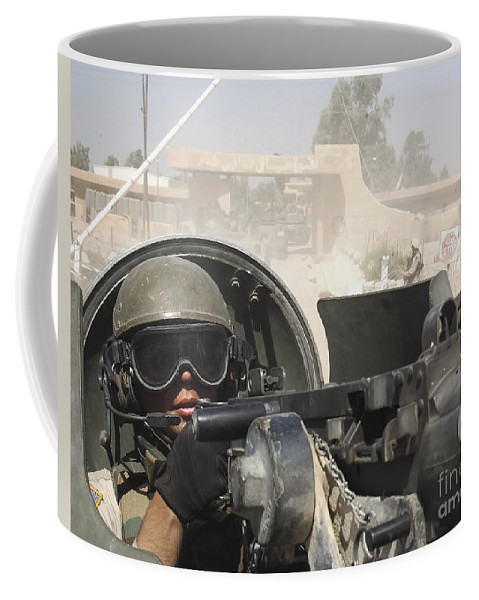 Color Image Coffee Mug featuring the photograph Soldier Pulls Security From The Hatch by Stocktrek Images