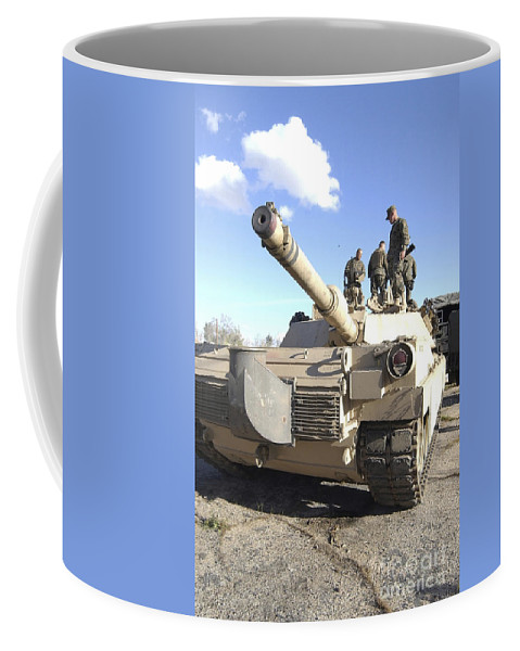 Vertical Coffee Mug featuring the photograph Soldiers Get Their Battletank Ready by Stocktrek Images