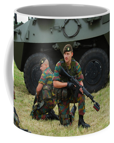 5.56mm Coffee Mug featuring the photograph Soldiers Of An Infantry Unit by Luc De Jaeger