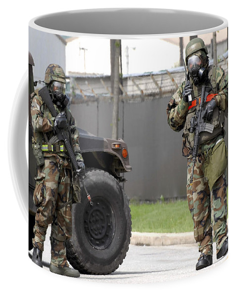 M16 Coffee Mug featuring the photograph Soldiers Stand Guard At An Intersection by Stocktrek Images