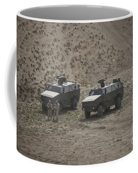 Mrap Coffee Mug featuring the photograph Soldiers Stand Outside Their German Atf by Terry Moore