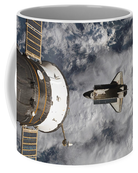 Aerial View Coffee Mug featuring the photograph Space Shuttle Atlantis And The Docked by Stocktrek Images