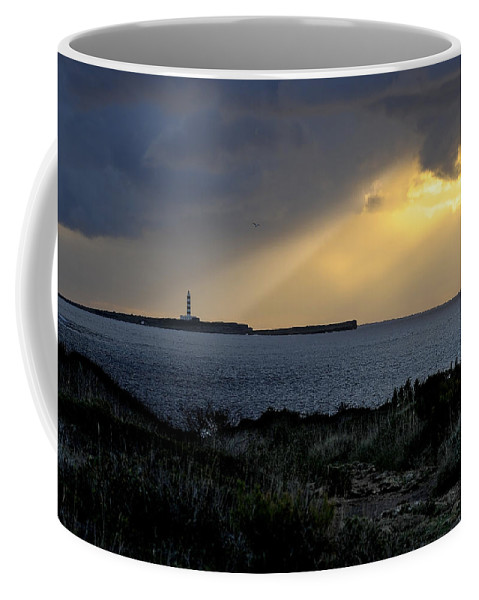 Outdoor Coffee Mug featuring the photograph storm light - A morning light iluminates lighthouse through clouds in an amazing landscape by Pedro Cardona Llambias