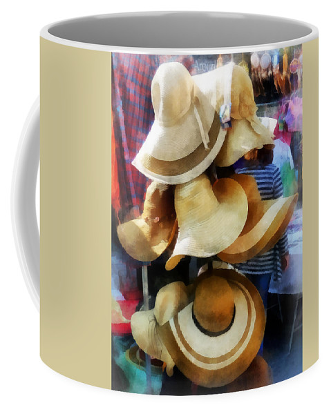 Hat Coffee Mug featuring the photograph Straw Hats by Susan Savad