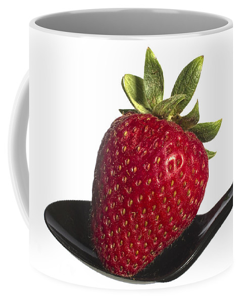 Art Coffee Mug featuring the photograph Strawberry On A Black Spoon Against White No.0003 by Randall Nyhof