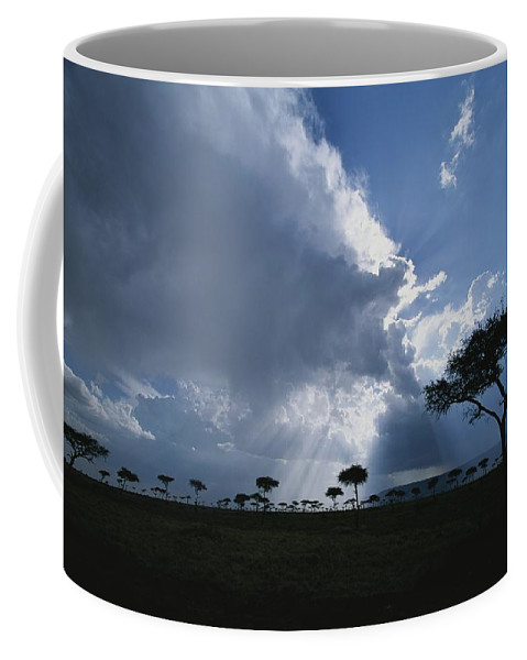 Africa Coffee Mug featuring the photograph Sun Rays Break Through Clouds by Roy Toft