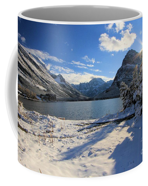 Swiftcurrent Lake Coffee Mug featuring the photograph Swiftcurrent Sunburst by Adam Jewell