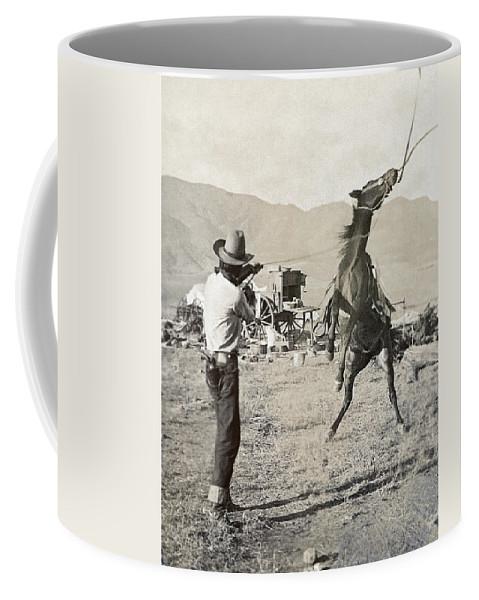 1910 Coffee Mug featuring the photograph Texas: Cowboy, C1910 by Granger