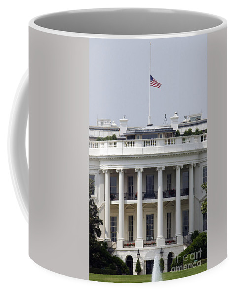 Washington Dc Coffee Mug featuring the photograph The American Flag Flies At Half-staff by Stocktrek Images