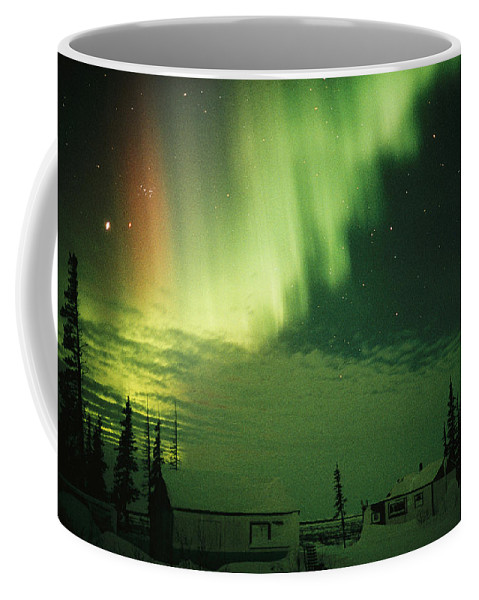 Scenes And Views Coffee Mug featuring the photograph The Aurora Borealis Shimmers by Norbert Rosing