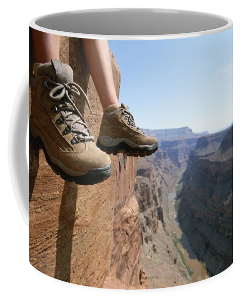 North America Coffee Mug featuring the photograph The Boot-shod Feet Of A Hiker Dangle by John Burcham