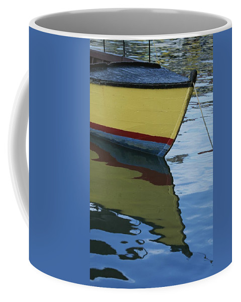 Boats Coffee Mug featuring the photograph The Bow Of An Anchored, Striped Boat by Michael Melford