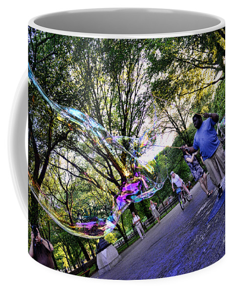 The Bubble Man Of Central Park Coffee Mug featuring the photograph The Bubble Man Of Central Park by Paul Ward