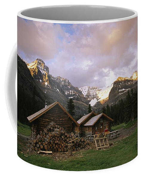 North America Coffee Mug featuring the photograph The Elizabeth Parker Hut, A Log Cabin by Michael Melford