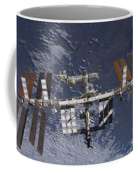 Terra Coffee Mug featuring the photograph The International Space Station by Stocktrek Images