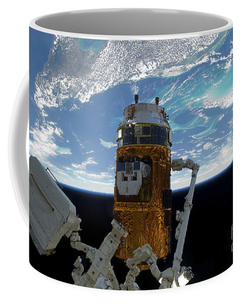 View From Space Coffee Mug featuring the photograph The Japanese H-ii Transfer Vehicle by Stocktrek Images