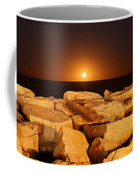 Beauty In Nature Coffee Mug featuring the photograph The Moon Rising Behind Rocks Lit by Luis Argerich