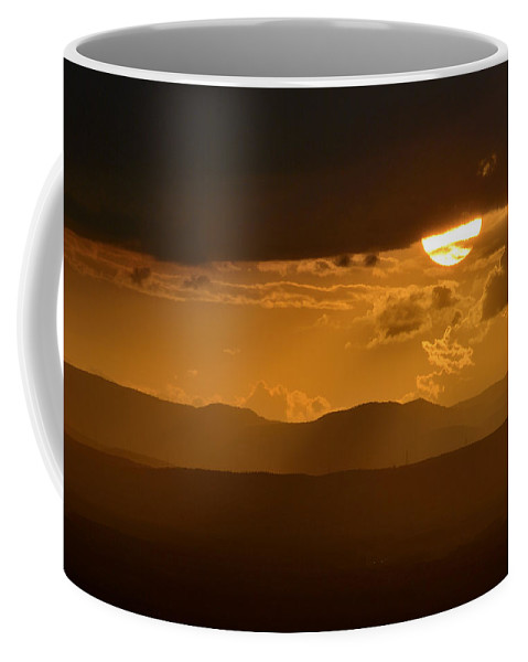 Sunset Coffee Mug featuring the photograph The Sun And De Storm by Guido Montanes Castillo