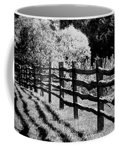 Fence Coffee Mug featuring the photograph The Wooden Fence by Mike Nellums