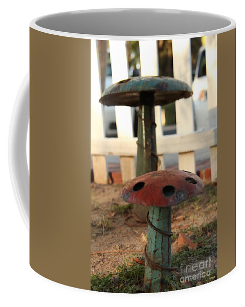 Ornamental Iron Pieces In Front Yard Coffee Mug featuring the photograph Topped by Diane Greco-Lesser