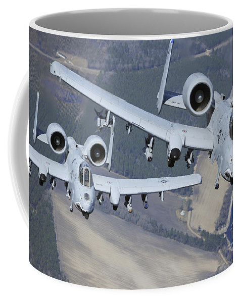 Ground-attack Aircraft Coffee Mug featuring the photograph Two A-10c Thunderbolt II Aircraft Fly by Stocktrek Images