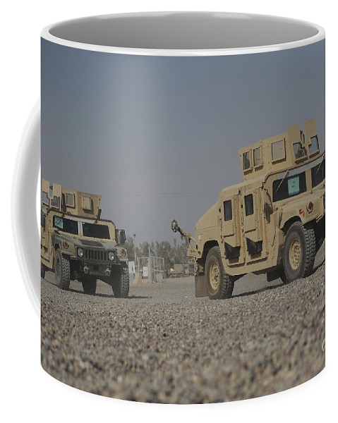 Horizontal Coffee Mug featuring the photograph Two M1114 Humvee Vehicles At Camp Taji by Stocktrek Images