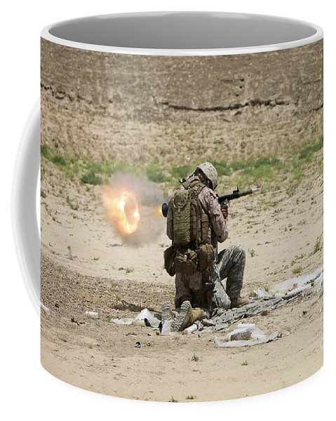 Afghanistan Coffee Mug featuring the photograph U.s. Army Soldier Fires by Terry Moore