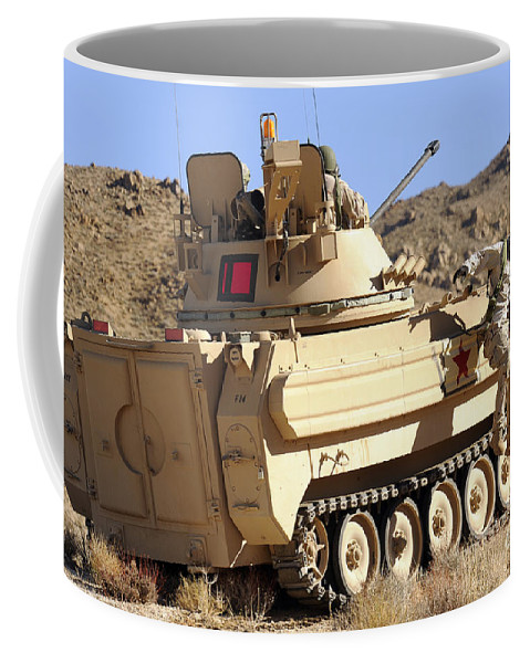 National Training Center Coffee Mug featuring the photograph U.s. Army Soldier Jumps Off An M113 by Stocktrek Images