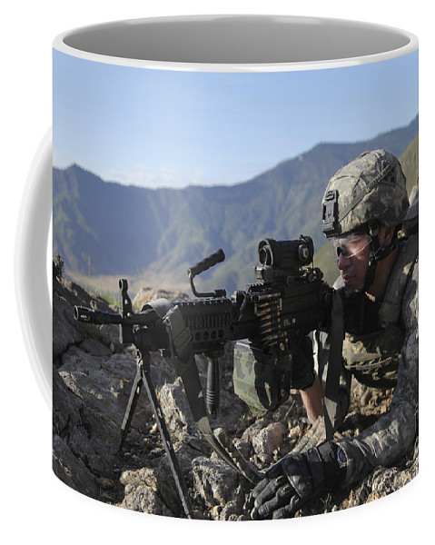 Waist Up Coffee Mug featuring the photograph U.s. Army Soldier Provides Overwatch by Stocktrek Images