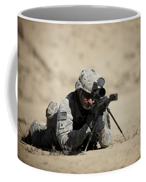 Operation Enduring Freedom Coffee Mug featuring the photograph U.s. Army Soldier Sights In A Barrett by Terry Moore