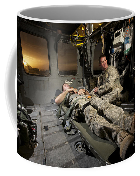 Us Army Coffee Mug featuring the photograph U.s. Army Specialist Practices Giving by Terry Moore