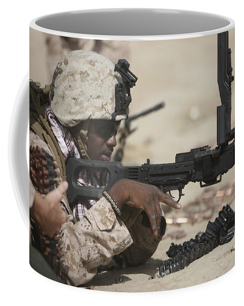 Afghanistan Coffee Mug featuring the photograph U.s. Marine Clears The Feed Tray by Terry Moore