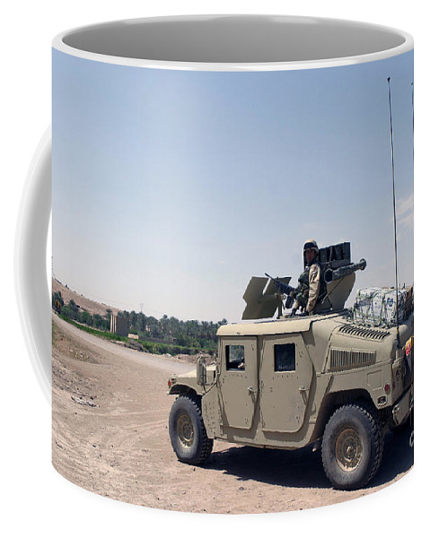 Horizontal Coffee Mug featuring the photograph U.s. Marine Pulls Security On Top by Stocktrek Images